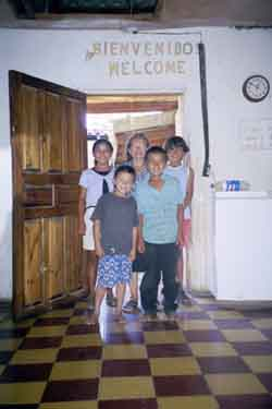 Clementina with children from her soup kitchen